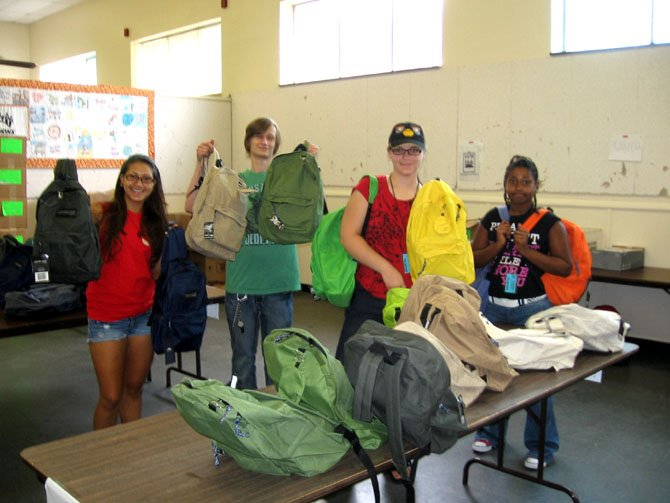 UCM exceeded its goal to raise $10,000 and collect 1,000 backpacks for the children and youth in UCM's programs. Each backpack contains approximately $40 worth of school supplies. Student volunteers put the final touches on the remaining backpacks to be donated to needy students in the Route 1 Corridor. From left are Brenda Arriaza, Hayfield Secondary School; Cody Binstock, Mount Vernon High School; Kelly Gallagher, Bishop Ireton High School, and Danielle Page, Woodbridge Middle School.