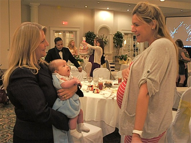 Virginia's First Lady Maureen McDonnell handles 7-week-old Connor Paszkiet like the pro that she is, having raised five of her own. Alana Dickenson, expecting her first, was no doubt picking up some helpful hints. Connor's mom couldn't get in the photo, as she was busy chasing Connor's 13-month-old sister, Kairi.