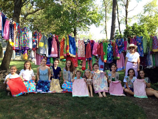 Mount Vernon Area Girl Scout Troop 874 made 82 dresses to send to an orphanage in Haiti. From left are Lauren and Lindsay Fisher, Shea Ruffin, Nina Shute, Maura Finn, Savannah Culver, Elizabeth Hutchison, Becky Lehner, Sarah McKeown, Chloe Harris, Emma Rice and Betsy Martin.