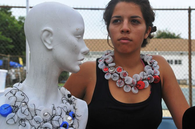 Jewelry designer Tamara Wilkerson showcases one of her recycled pieces along with a mannequin model. Tamara incorporates a lot of recycled materials in her work. Visit www.wirealmbytamara.etsy.com