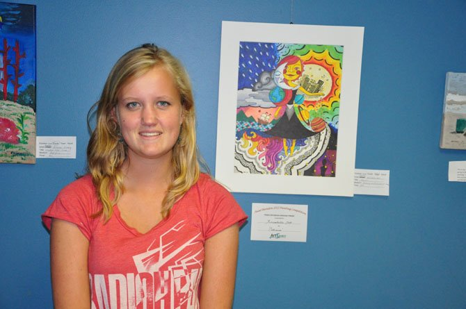 "Annabell Goll, winner of the teen division at the annual Paint Herndon competition Saturday, Sept. 1, with her painting, ""Collision."""
