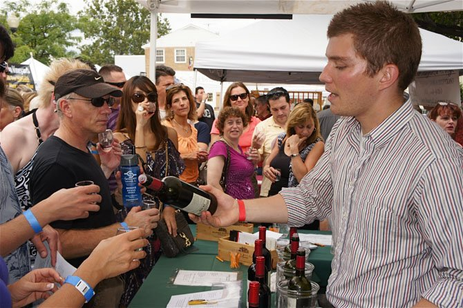 Adam Reinhard, an ABC manager from Barboursville Vineyards, has no trouble keeping up with all of the festival goers wanting to try a taste.