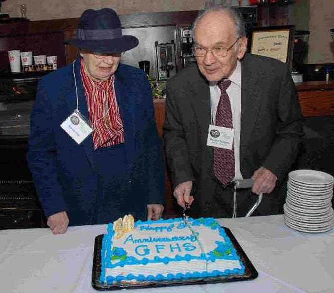 Marion Reid and Milburn Sanders, lifetime residents of Great Falls, honored by cutting the cake on the occasion of the 30th Anniversary Celebration of the Great Falls Historical Society, Feb. 19, 2008.