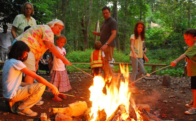 Families come together to roast marshmallows during a fireflies and s'mores campfire event at the Gulf Branch Nature Center on Sept. 1.