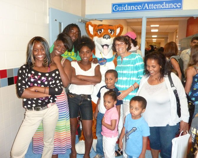 Dream Dog Foundation mascot Jazz the Dream Dog poses with director Lorraine Friedman, program participants and fans during Back to School Family Night Aug. 29 at T.C. Williams High School.