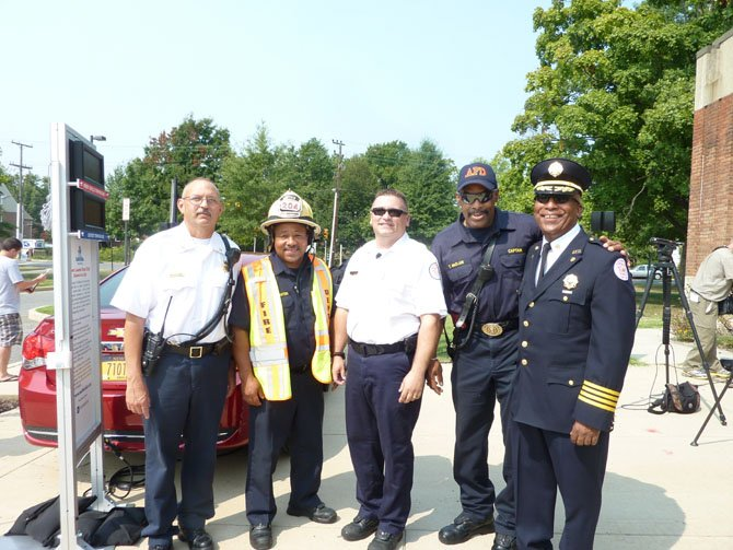 Firefighters Michael Brown, Anthony Watson, Brian Hricik, Thurston McClain and Andre Snead participate in the Aug. 17 launch of the Look Before You Lock campaign at George Washington Middle School.