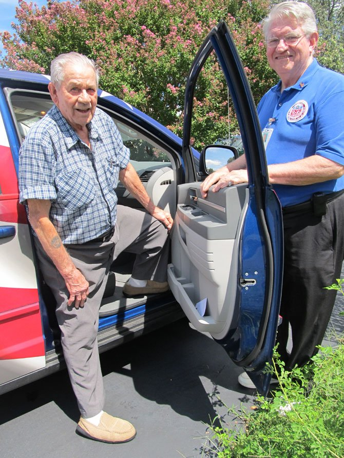 Dick Stohr of Springfield, right, volunteers with the Veterans Transportation Service to take disabled veterans to and from medical appointments. He is one of only 14 drivers that VTS has to cover Maryland, Washington, D.C., and Virginia routes.
