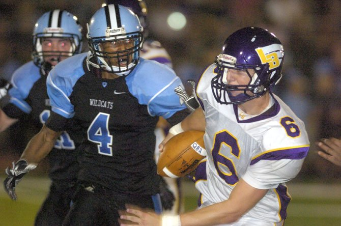 Centreville's Xavier Nickens-Yzer (4) chases after Lake Braddock quarterback Caleb Henderson on Aug. 31 at CHS.