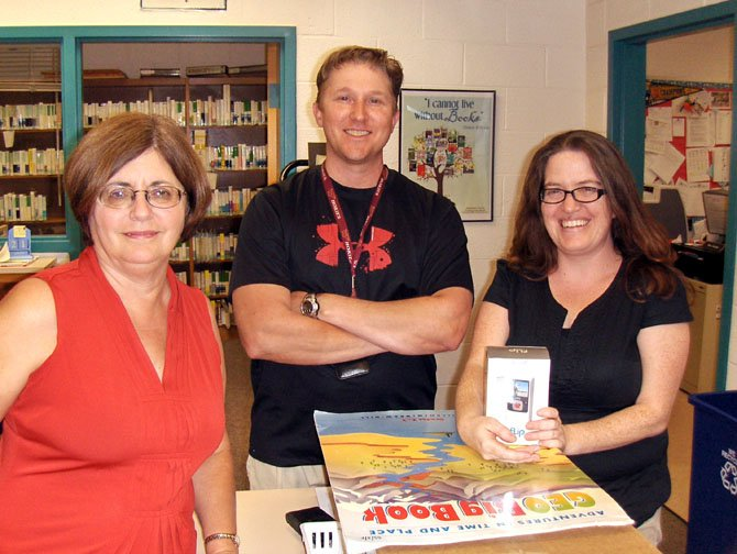 From left: Poplar Tree Elementary librarian Cindy Uncles, P.E. teacher Rob Thompson and special-ed teacher Mandy Moore are happy about the start of school.