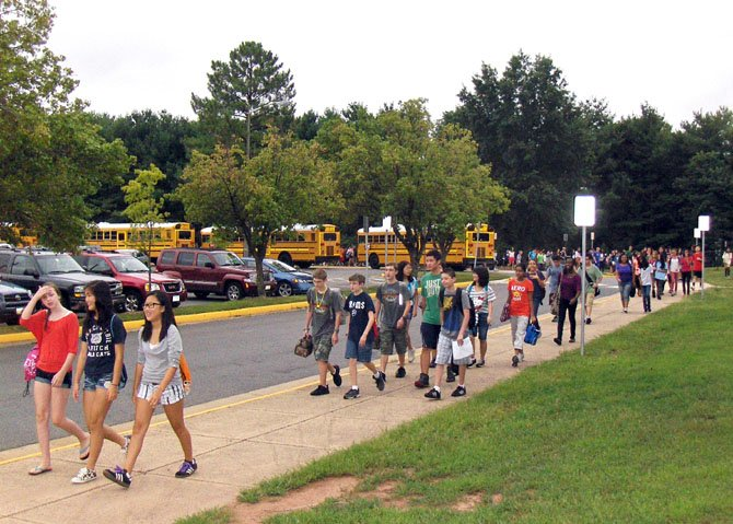 Rocky Run students walk from their buses to the school.
