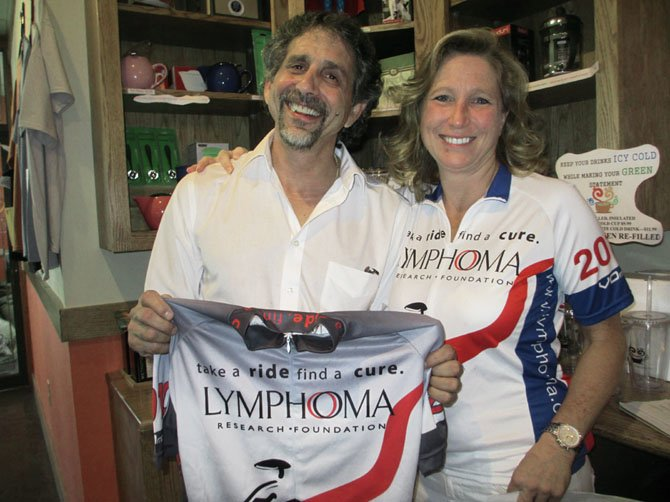 Remission Ride team leader Valerie Kappler with Caffe Amouri owner Michael Amouri at the shop's Coffee for a Cure on Sept. 7.