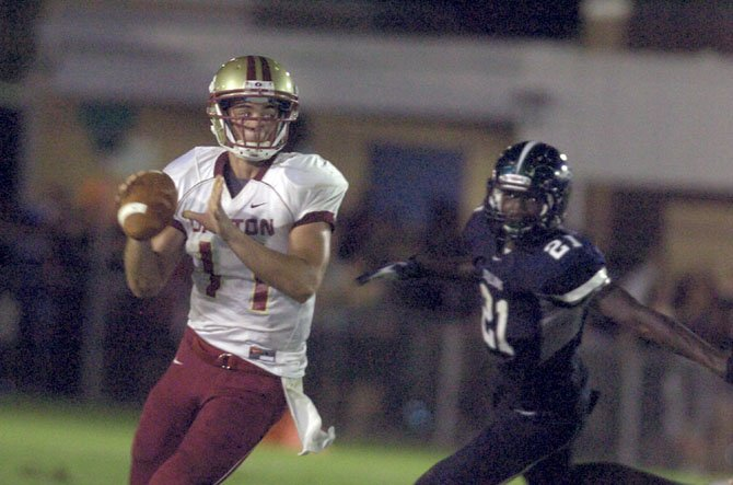 Oakton senior quarterback Kyle Downer threw three touchdown passes and ran for one during a 28-21 victory against South County on Sept. 7.