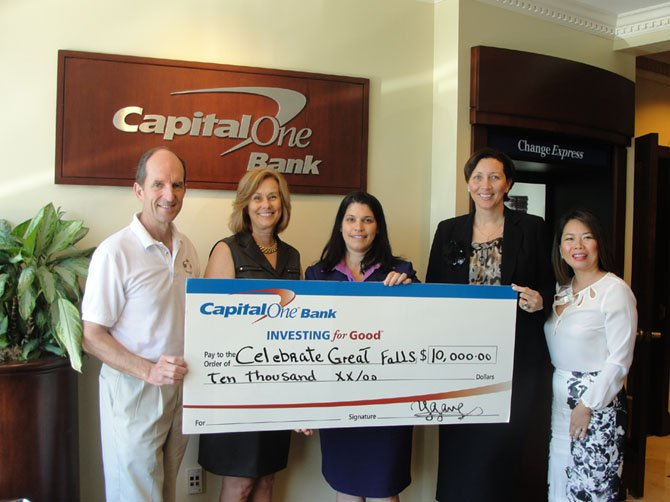 Mike Kearney and Candace Campbell of Celebrate Great Falls receive Capital One Bank's donation from Yenisel Gamez, Great Falls branch manager, Heidi Joseph, district manager, and Trang Nguyen-Do, vice president, business banking.