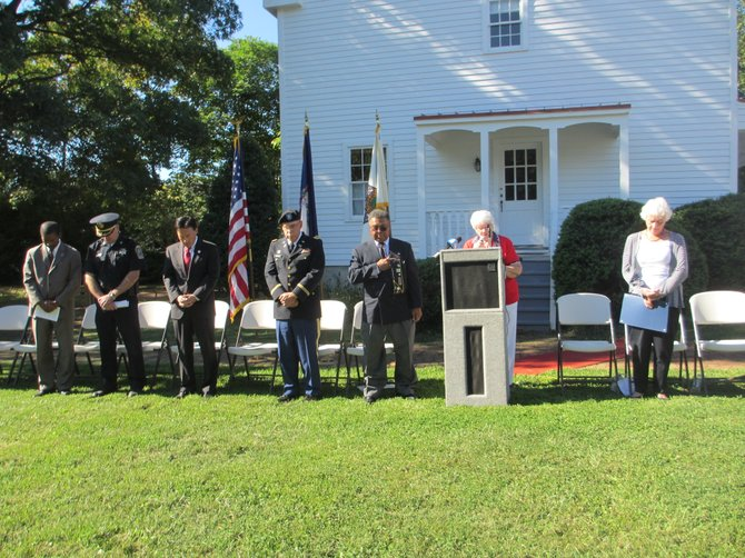 American Legion Auxiliary 180 member Martha Hatter gives the invocation on the grounds of Freeman House.