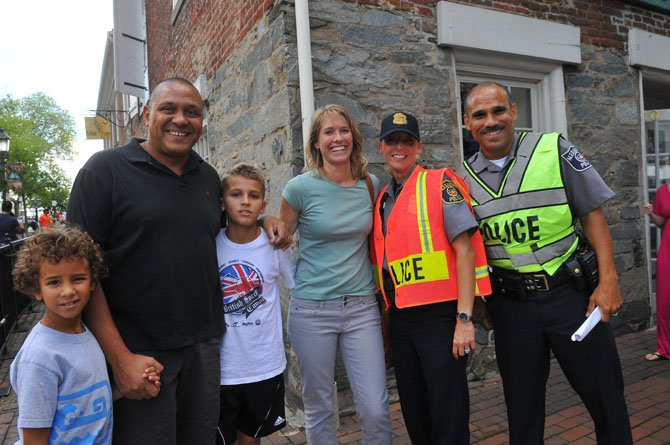 Hassan, Laura, Kenan and Everett Aidan greet friends Sgt. Tara May and Det. Victor Ignacio at the Festival.