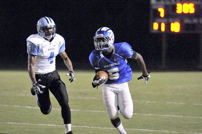 Demornay Pierson-El runs with the ball while being chased by a Centreville defender on Sept. 7.