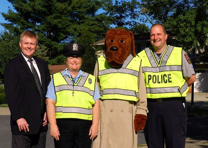 (From left) Supervisor John Cook, Shirley Hanson, the Laurel Hill Elementary School crossing guard,