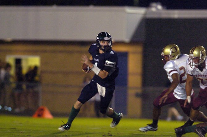 South County quarterback David Symmes scored three rushing touchdowns against Oakton on Sept. 7.