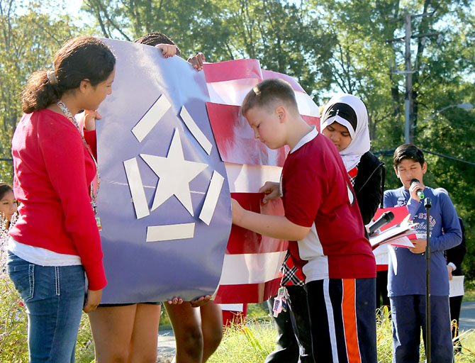 Sixth graders create a model of the Freedom Flag.