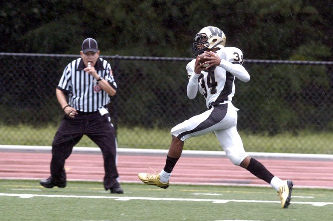 Westfield receiver Devon Burns hauls in one of three touchdown receptions on the day against T.C. Williams on Sept. 8.