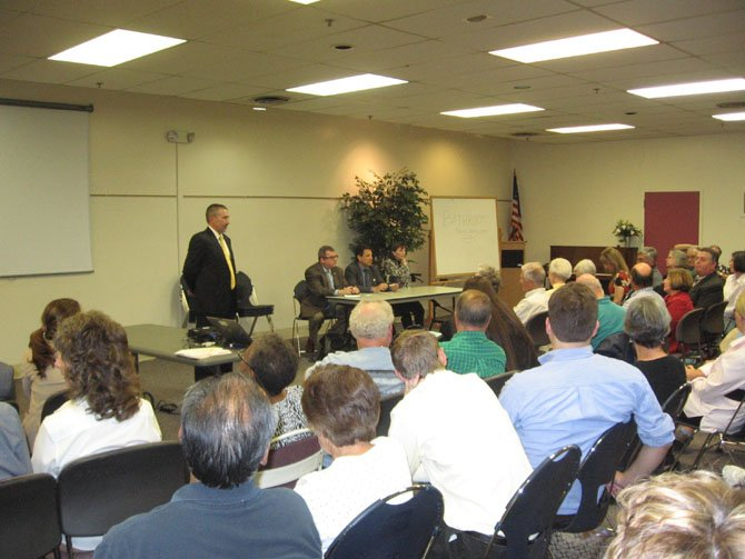 At the Town Hall Meeting jointly held by Dominion Power and Mount Vernon area state legislators at Sherwood Hall Library are, from left, standing: Vice President of Dominion Power for Distribution Operations Rodney Blevins; seated: State Sen. Adam Ebbin, Del Scott Surovell, and state Sen. Toddy Puller.