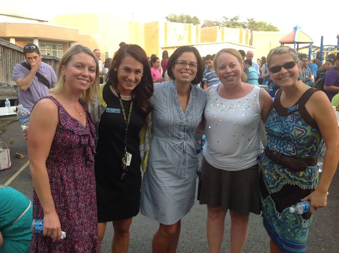 Returning teachers and new teachers enjoy their time together. From left are Shele Banford, Kasey Calderone, Staci McFadden, Melissa Morgan and Kelley Dever.