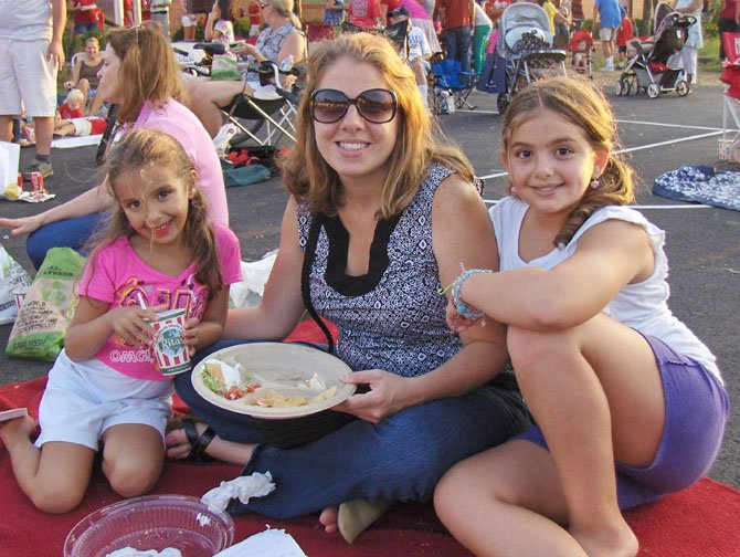 Sandra Ammar enjoys a picnic supper with daughters Juliana (on left), in first grade, and Yasmine, in fourth grade.