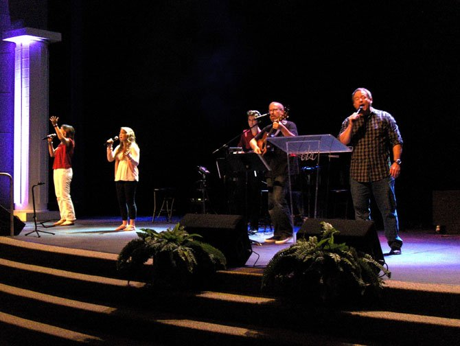The praise band performs during Sunday's contemporary worship service.
