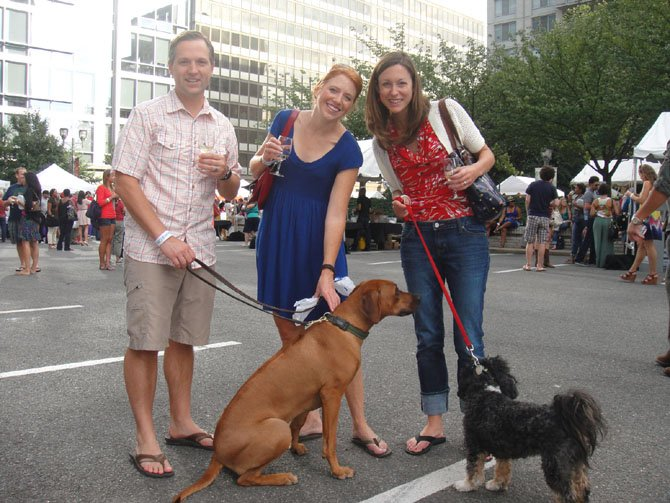 Allison Sherry, Jenny Sullivan and Matt Seiler enjoy the Crystal City Taste of Wine and Jazz festival with their pups Laurel and Pilar on Sunday, Sept. 16.