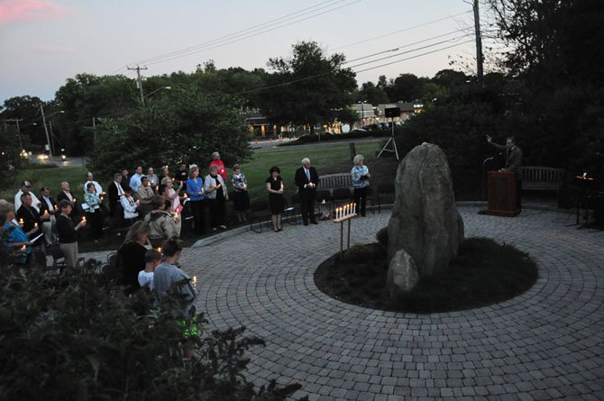 Attendees light candles at the Great Falls Freedom Memorial Tuesday, Sept. 11, in memory of those lost on 9/11.