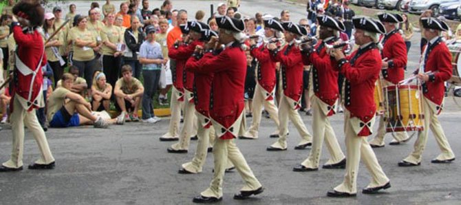 The Old Guard Fife and Drum Corps performs at last year's McLean 5K. This year's will raise money for transitional housing for Wounded Warriors at Vinson Hall.