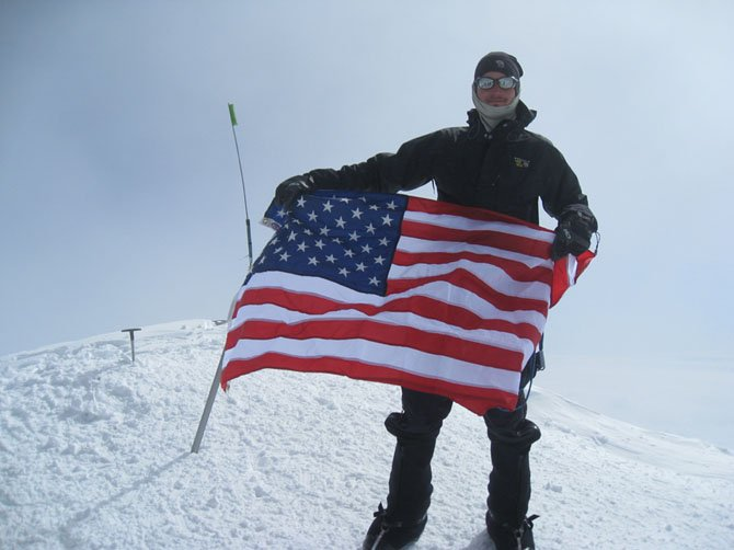 Brian DeMocker, of McLean, displaying the USA colors at the Denali summit in Alaska, July 1, 2012 at 20,320 feet.