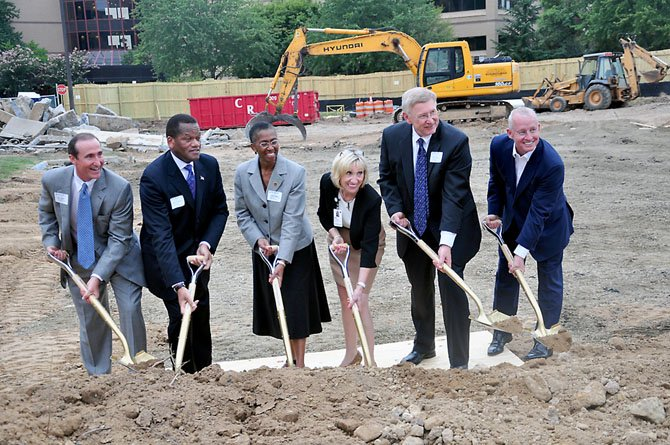 From left, Mark Ingrao of the Reston Chamber of Commerce, Milton Matthews, CEO of the Reston Association, Supervisor Cathy Hudgins (D-Hunter Mill), Jane Raymond of Reston Hospital, Supervisor John Foust (D-Dranesville) and Joe Ritchey break ground for the new Reston Hospital building Monday, Sept. 17.