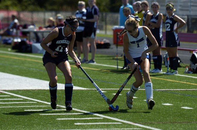 Senior captain Kelsie Whalen, right, is the West Potomac field hockey teams leading goal scorer.