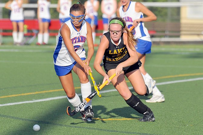 Taylor Livick, right, and the Lake Braddock field hockey team improved to 7-3 with a victory against T.C. Williams on Sept. 14.