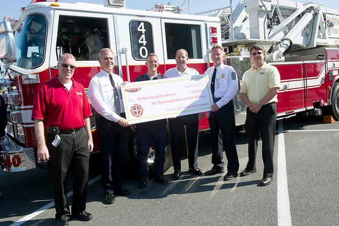 (From left) are Firehouse Subs' Mark Gilbert, Asst. Fire Chief John Caussin, Battalion Chief Chris Schaff, Fire Chief Ron Mastin, Deputy Fire Chief James Walsh and Firehouse Subs' Dan Lowe.