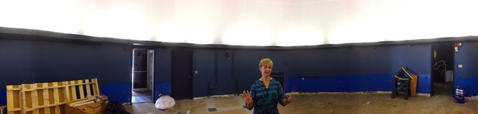 Alice Monet stands inside the planetarium as renovation is about to be completed.