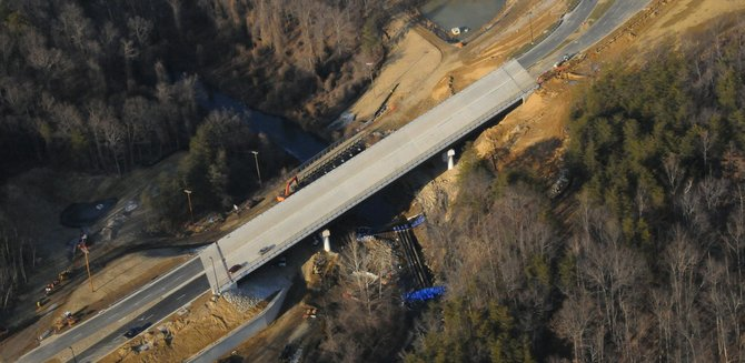 A view of the North Loop Road Bridge as it crosses over the construction of a Coffer Dam at Accotink Creek at the National Geospatial-Intelligence Agency Campus East project.