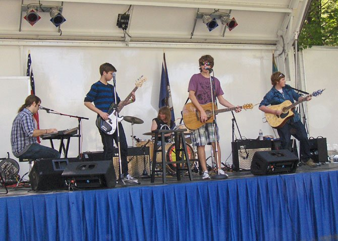 A teen band entertains the crowd.