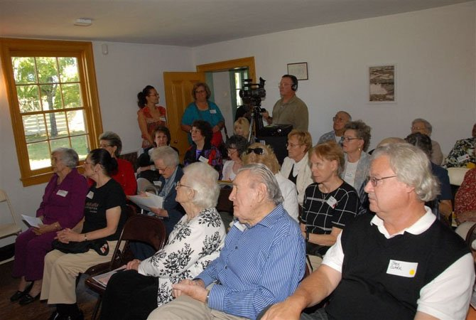 Seniors observe a presentation on the history of the Dranesville Tavern at the Great Falls Senior Center Without Walls event Tuesday, Sept. 11.