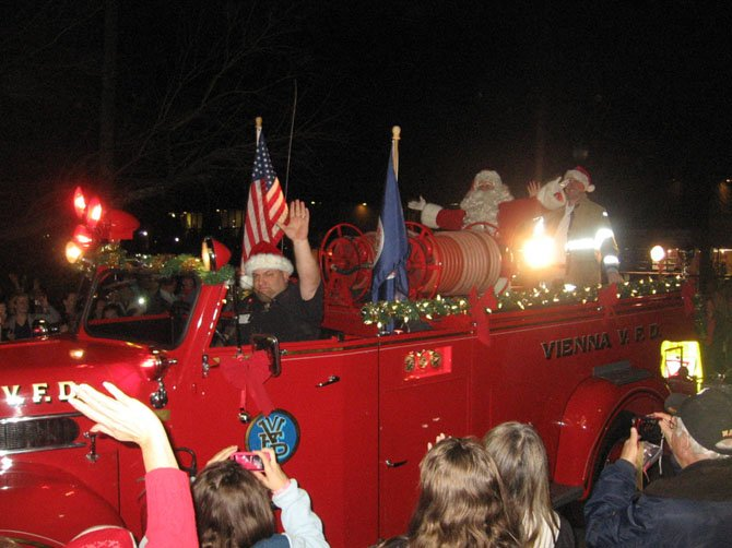 Screaming fire engine sirens herald the arrival of Santa Claus at the annual Church Street Holiday Stroll, always held the Monday after Thanksgiving.