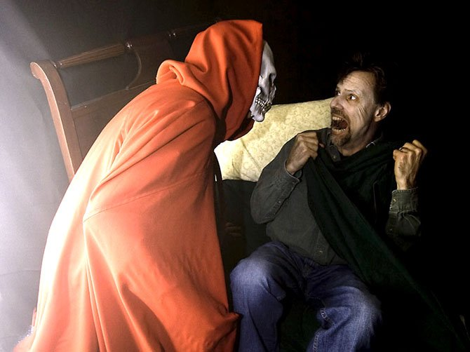 A visitor to the Bradley Farm Haunted House gets a fright. This year's haunted house will take place Oct. 26 and 27 and will raise money for Herndon-Reston FISH.