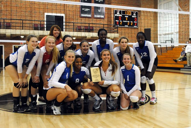 The T.C. Williams volleyball team won the Alexandra City Volleyball Tournament on Sept. 14. From left are: (front row) Sydney Trout, Emerald Taylor, Kate Whitmire, Caroline Chamberlain, (back row) Audrey Dervarics, Savannah Devereux, Kelly Dervarics, Emma Goldberg, McKayla Robinson, Trish Brown, Iye Massaquoi and assistant coach Melanie Bradshaw. The Titans are 8-1 and will host West Springfield on Oct. 2.