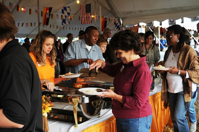 German sausages and sauerkraut are served up in the food tent at the annual Ft. Belvoir Oktoberfest in 2011.