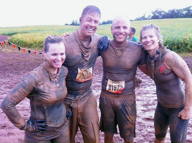 """Team Grace"" at the Tough Mudder event in honor of sister, Grace Thomas LeGros, who died from brain cancer in January. Left to right, Kris Floyd Thomas, Rich Thomas, Tom Bresnahan and Kim Thomas Krongaard."