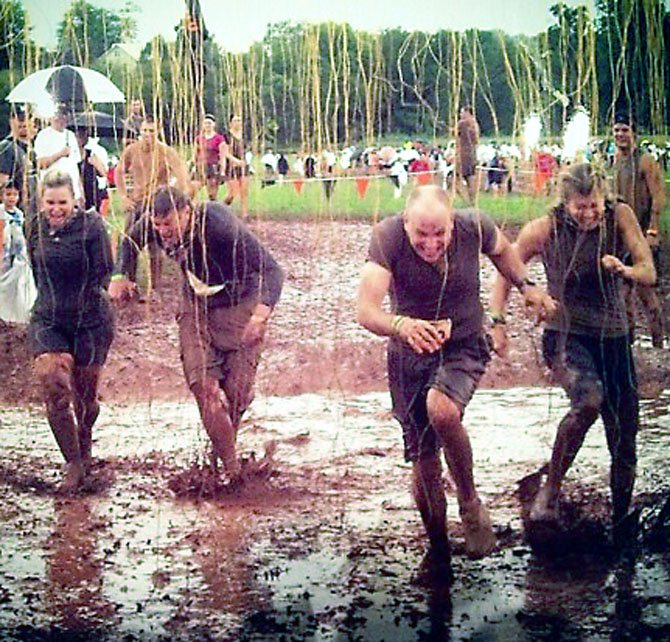 "Shock Therapy: 10,000 volts of electricity rained down on ""Team Grace"" during the Tough Mudder race for Wounded Warriors."