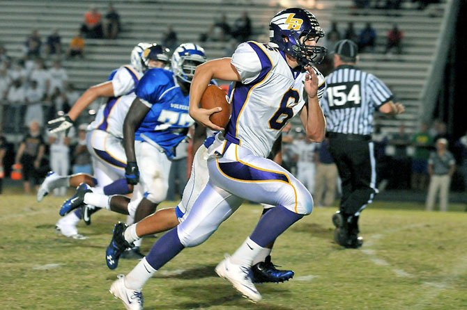 Lake Braddock quarterback Caleb Henderson on Sept. 21 led the Bruins to a win during his first game back at West Potomac High School, where he played varsity football as a sophomore.