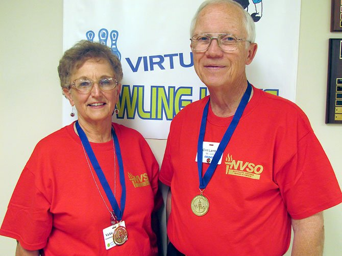 Clint and Vickie Lambert sporting their 2012 gold medals.