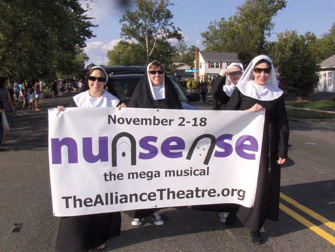 "Actresses from The Alliance Theatre march in Chantilly High's Sept. 21 Homecoming Parade to advertise their upcoming musical comedy, ""Nunsense."""