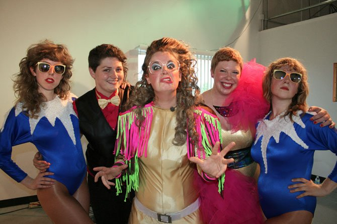 """Married in Spandex,"" a new documentary from Arlington filmmakers Devin Gallagher and Allison Kole, tells the story of Rachel and Amanda's wedding day, which featured a spandex-clad wedding party and a performance by Leslie Hall, center, and the Ly's. Turanski is to the left of Leslie, and Kole is to her right."